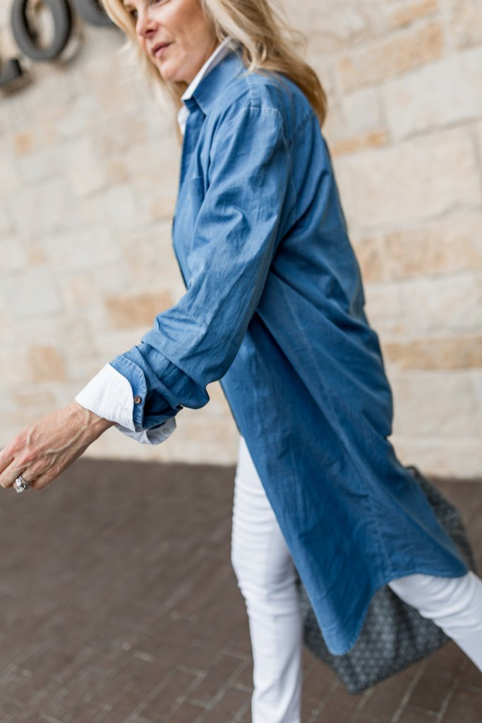 Chambray shirt dress used as a jacket over white jeans and crisp white shirt.