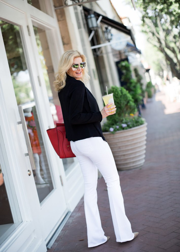 Chico's black travelers collection sweater with white Frame denim jeans