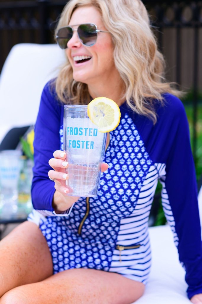 Tanya Foster in cabana life swimsuit holding Tervis Frosted Foster cup