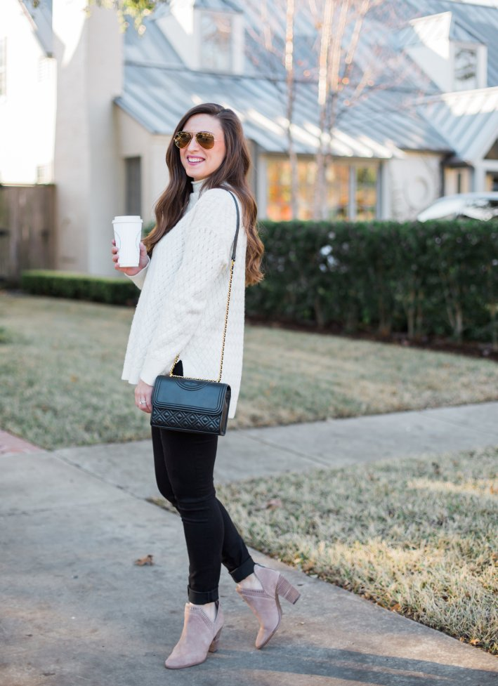 White casual sweater with skinny jeans and booties