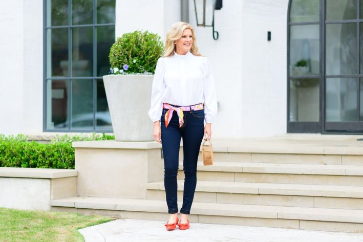 Tanya Foster standing in a MANGO blouse with veronica beard kate skinny jeans and a hermes scarf belt with shopbop flats