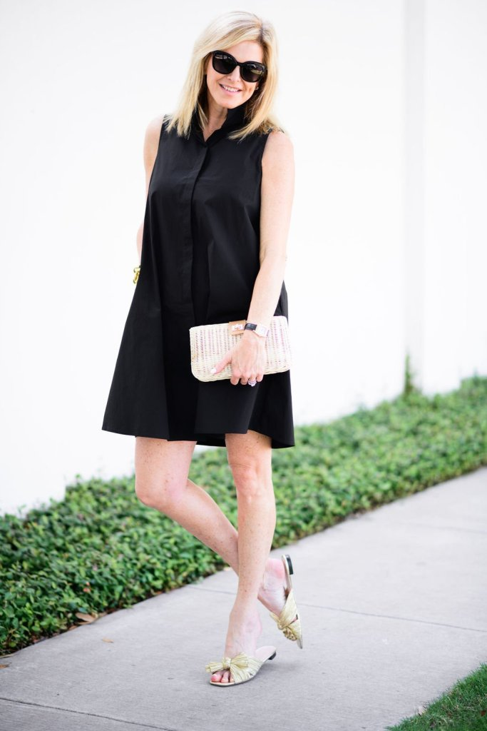 Tanya Foster wearing Tuckernuck black dress with tuckernuck clutch