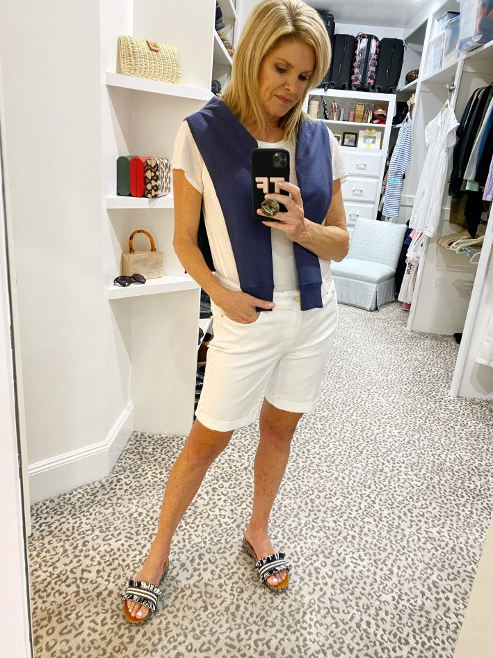 tanya foster in white talbots denim girlfriend shorts cabana life crew neck sweater and white crew tee with coach brayden sandals