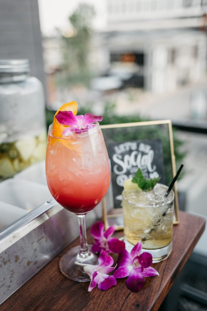 Tanya Foster visits Boston and shares her recommendations | Destination: Boston, Massachusetts Travel Guide by popular Dallas travel blogger, Tanya Foster: image of cocktail drinks next to some orchid flowers.