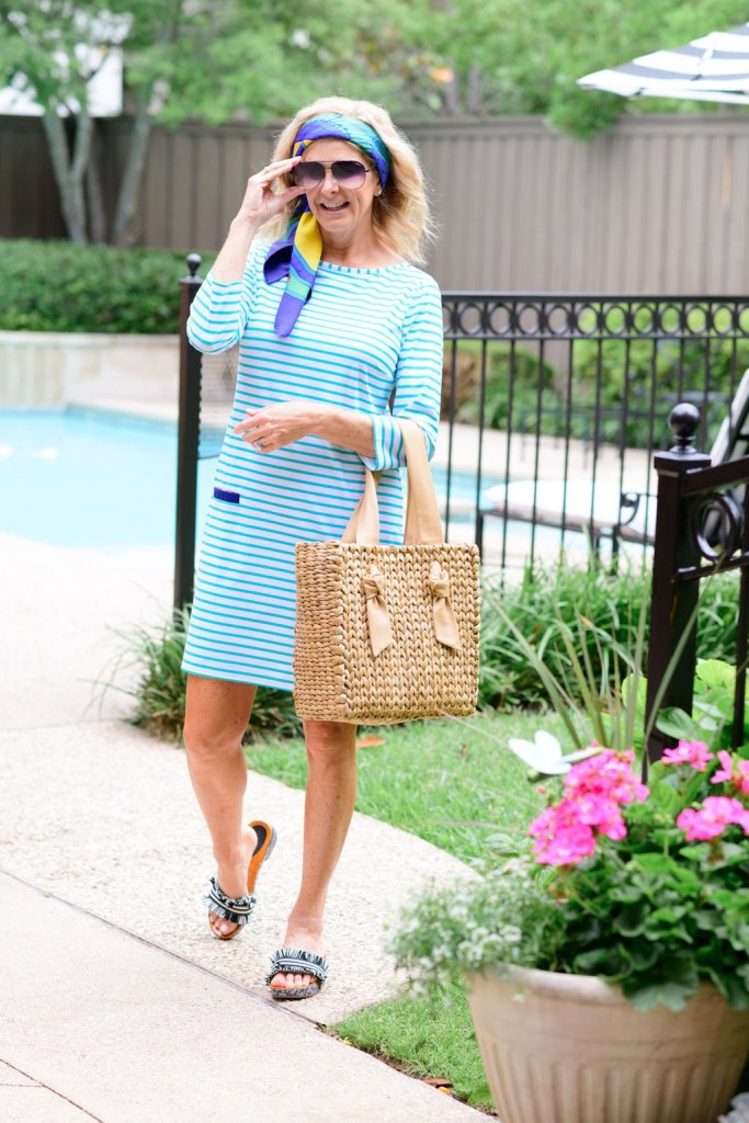 tanya foster summer outdoor entertaining look in cabana life dress coach shoes and wicker tote bag with hermes scarf as a head band with tom ford sunglasses
