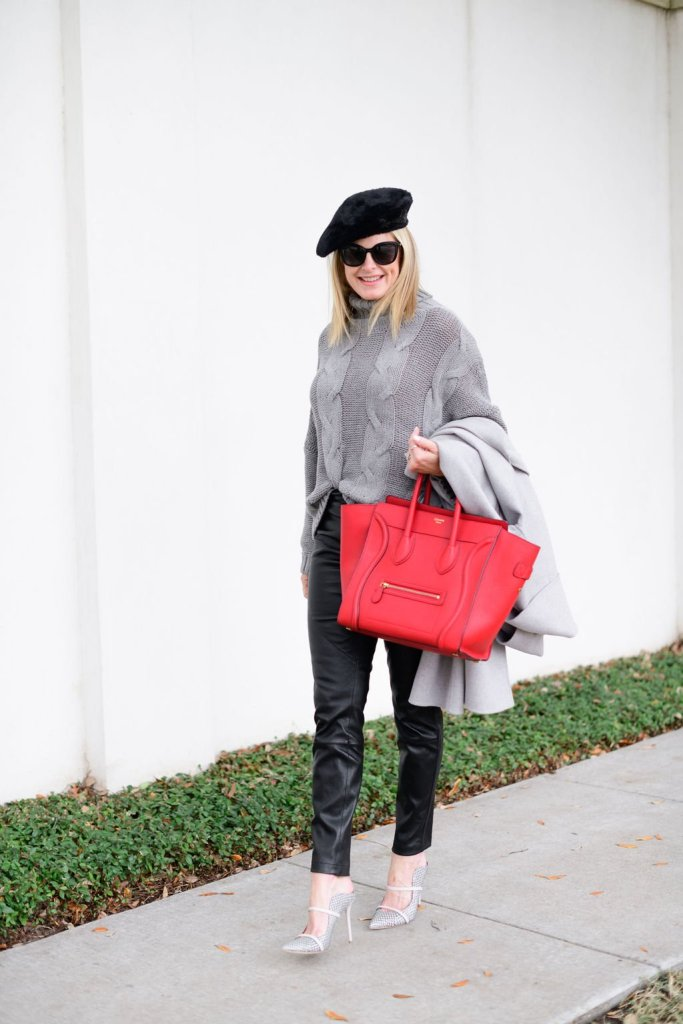 Tanya foster wearing chico's faux leather pants, amazon gray sweater hermes red bag and beret