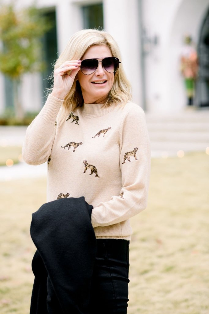 Tanya Foster in leopard chico's sweater with black good american jeans and cuyana wrap for a casual winter style