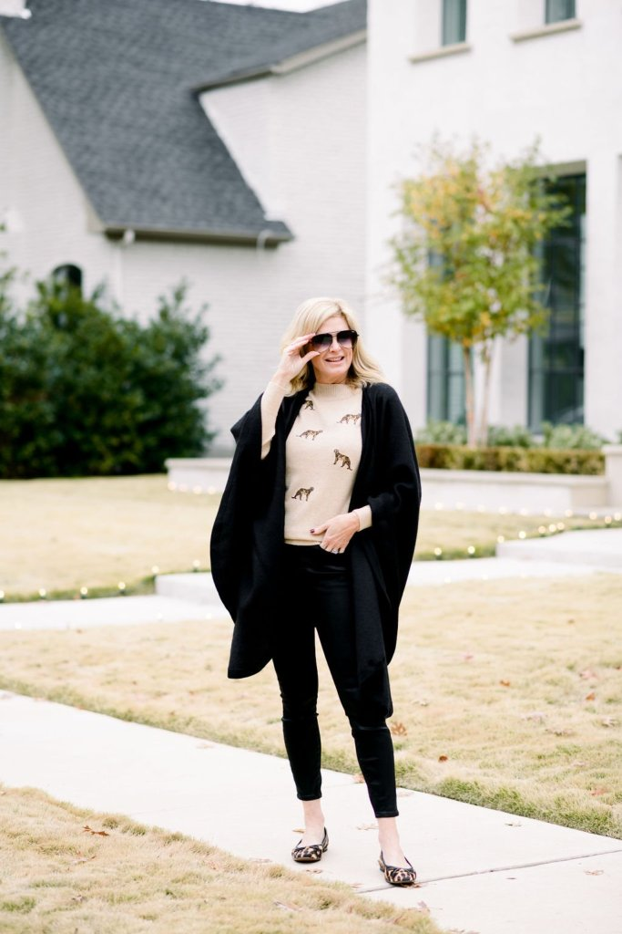Tanya Foster in leopard chico's sweater with black good american jeans and cuyana wrap