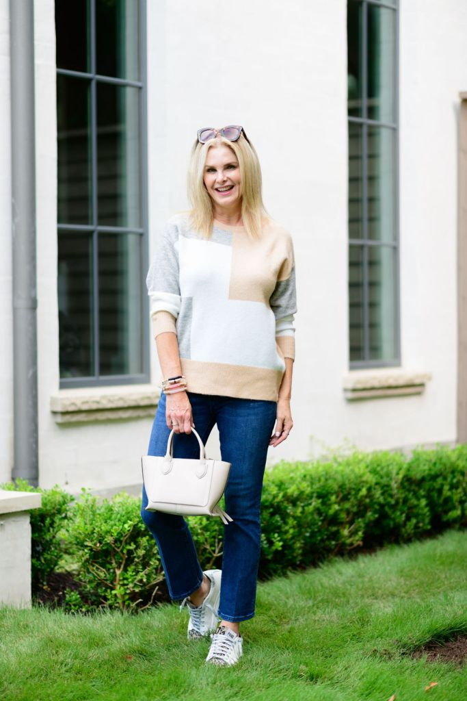 Tanya Foster wearing avara colorblock sweater ann taylor jeans and a longchamp bag