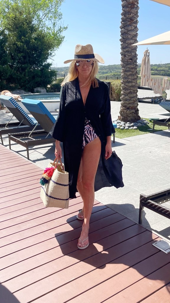 tanya foster in swimsuit and cover up with straw bag