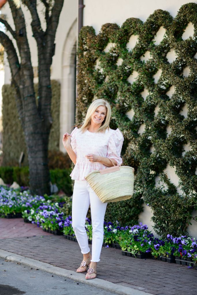 tanya foster wearing white jeans and dondolo blouse