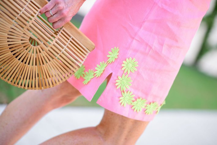 Tanya Foster in sail to sable pink embroidered dress for summer and arc bag