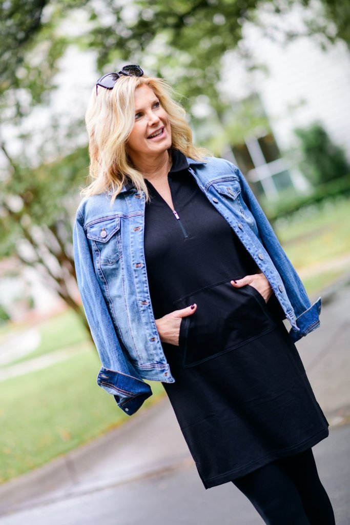 Tanya foster wearing a black half zip chico's dress and denim jacket for jacket season