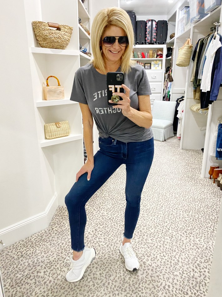 tanya foster in favorite daughter graphic tee paige denim jeans and adidas sneakers
