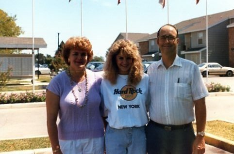 Tips on How to Move Forward After Losing a Parent by popular life and style blogger, Tanya Foster: image of a woman and her parents standing together outside in an apartment parking lot.