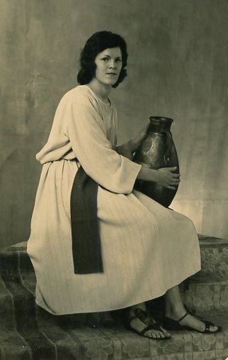 How to Move Forward After Losing a Parent by popular life and style blogger, Tanya Foster: black and white image of a woman sitting on some steps, dressed in Biblical period clothing and holding a large vase.