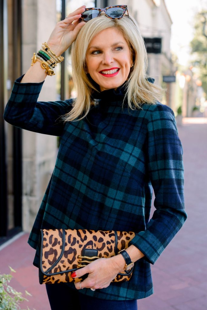Tanya foster wearing tuckernuck tartan top denim and aimee kestenberg animal print clutch