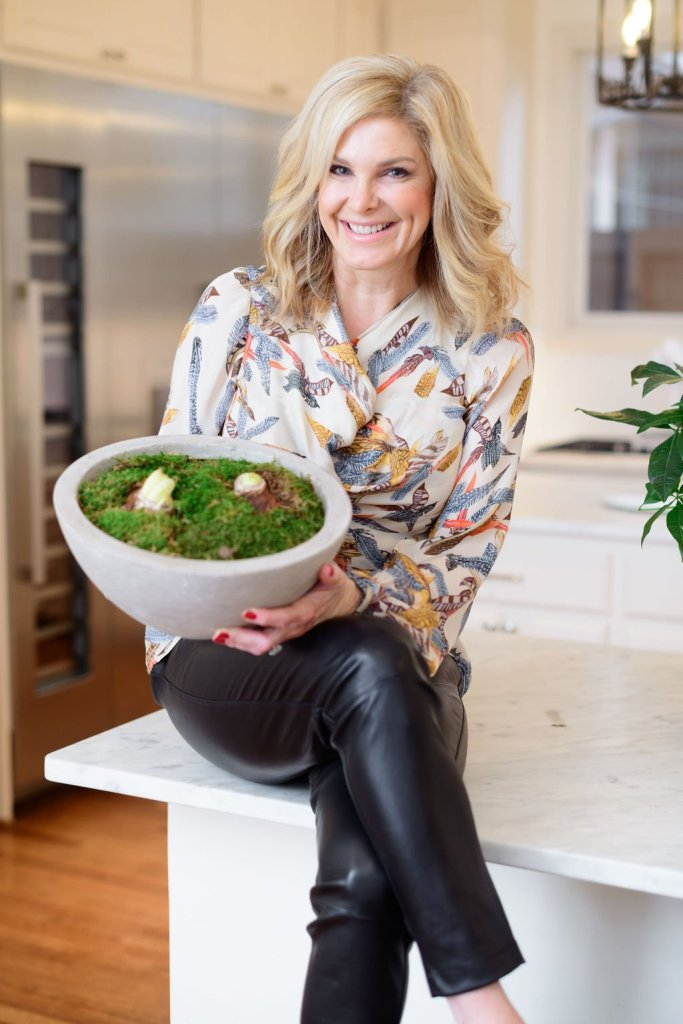 Tanya Foster holding Gardenuity herb plant