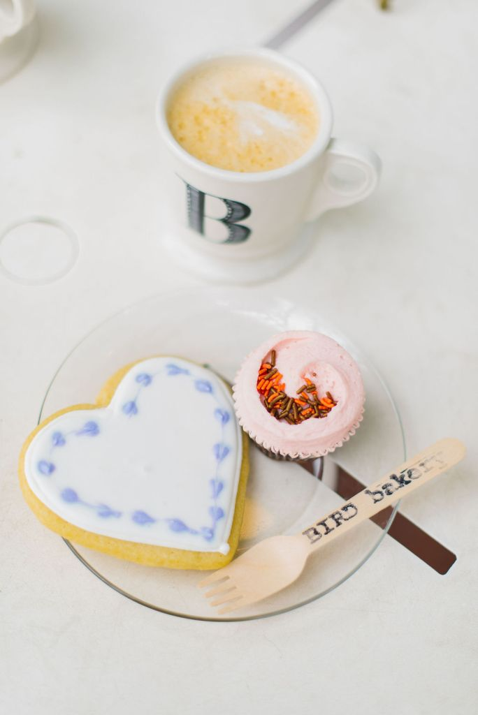 cup of coffee cookie and cupcake bird bakery
