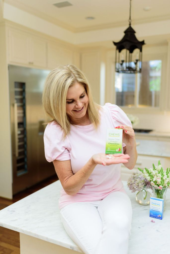 Tanya Foster holding Losers' chews ACV tablet