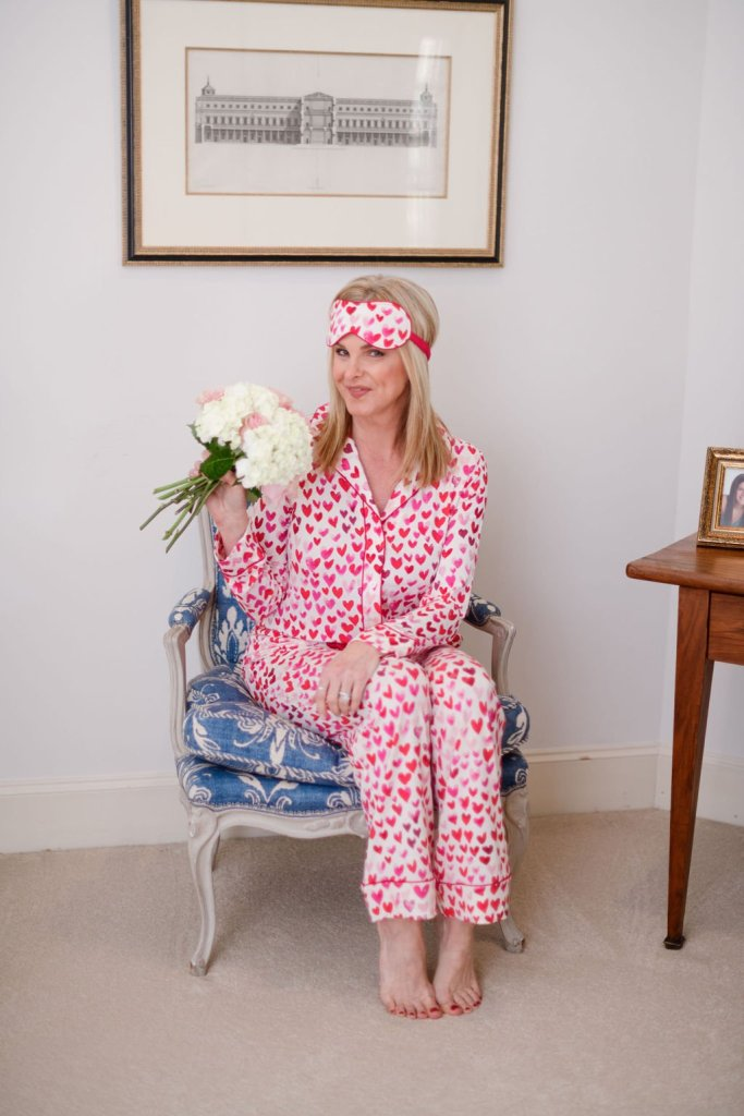 TAnya foster wearing soma heart pajamas and face mask holding flowers