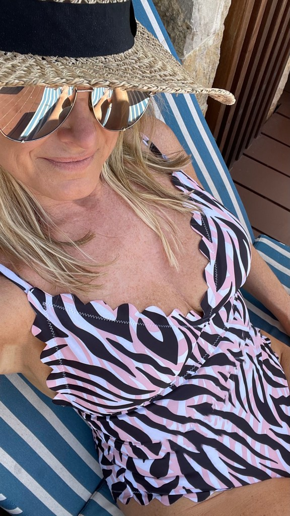 tanya foster wearing lounging in swimsuit