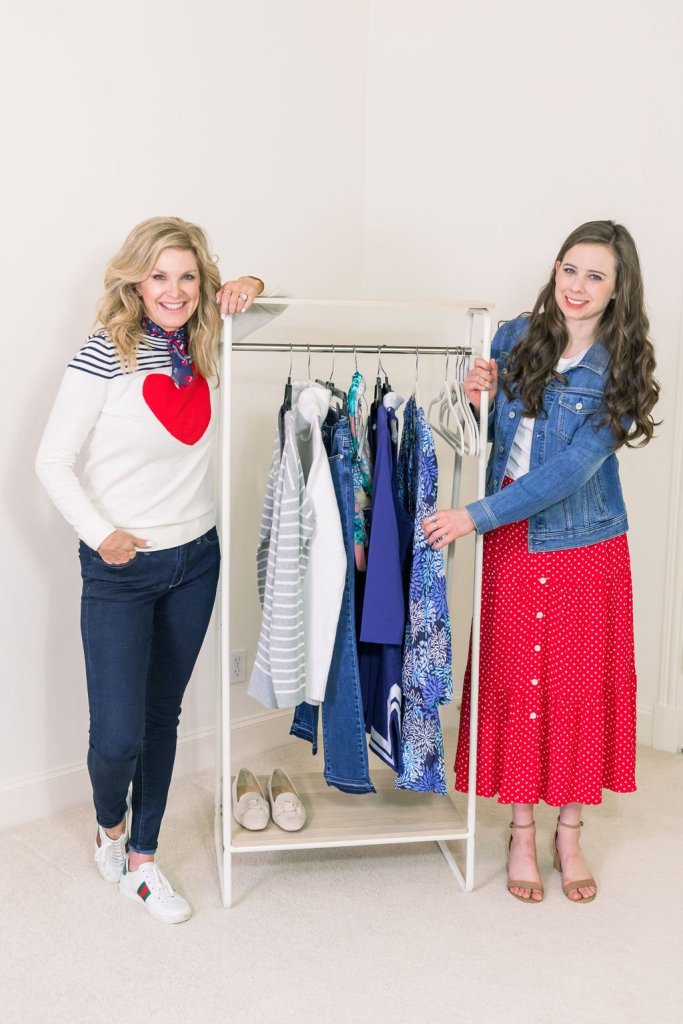 Tanya Foster and assistant standing in talbots clothes with a rack of clothes to prep for a travel photoshoot