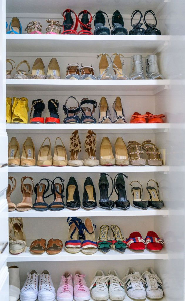 a closet rack full of shoes
