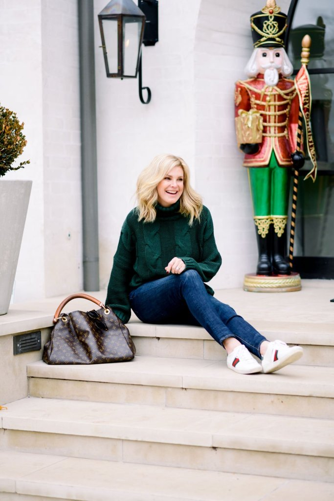 Tanya Foster in amazon cable knit green sweater denim gucci sneakers and louis vuitton purse