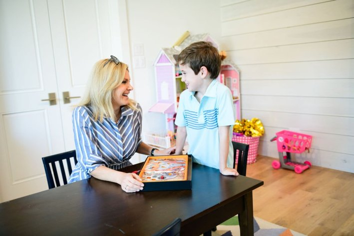 TAnya foster wearing eliza j dress playing games with boy wearing vineyard vines polo