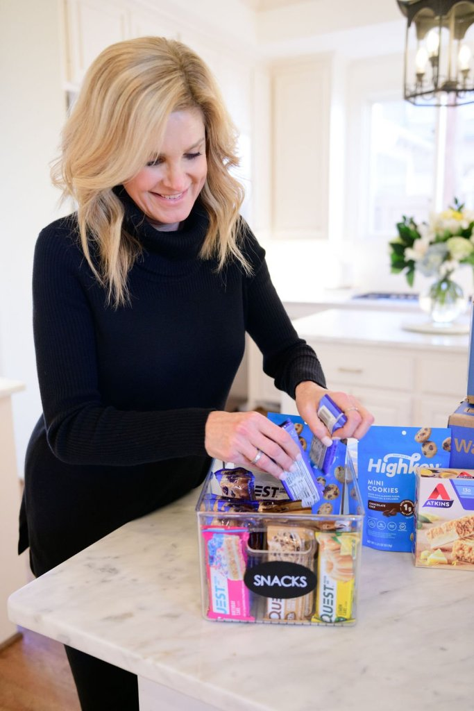 tanya foster putting quest bars in her snack drawer ordered from Walmart