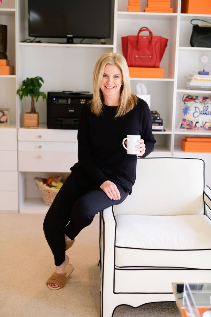 Tanya foster wearing Lou & Grey signature softblend sweatshirt and sweatpants holding a coffee cup