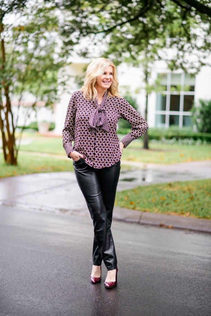 Tanya foster in chico's blouse and faux leather pants with m. gemi croc heels