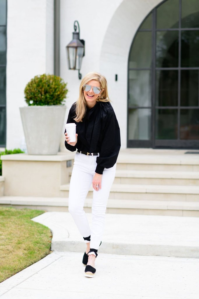 Tanya Foster wearing white jeans and black topshop blouse with vince camuto shoes