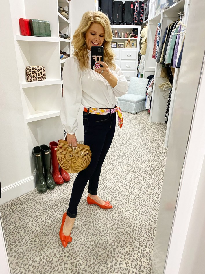 Tanya foster in a mango blouse with a hermes scarf belt arc bag and orange flats