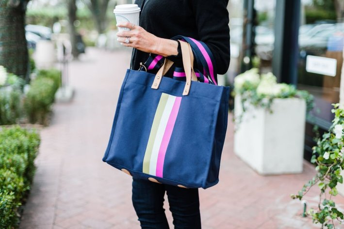 Tanya Foster holding a bagging rights tote-ally bag in navy