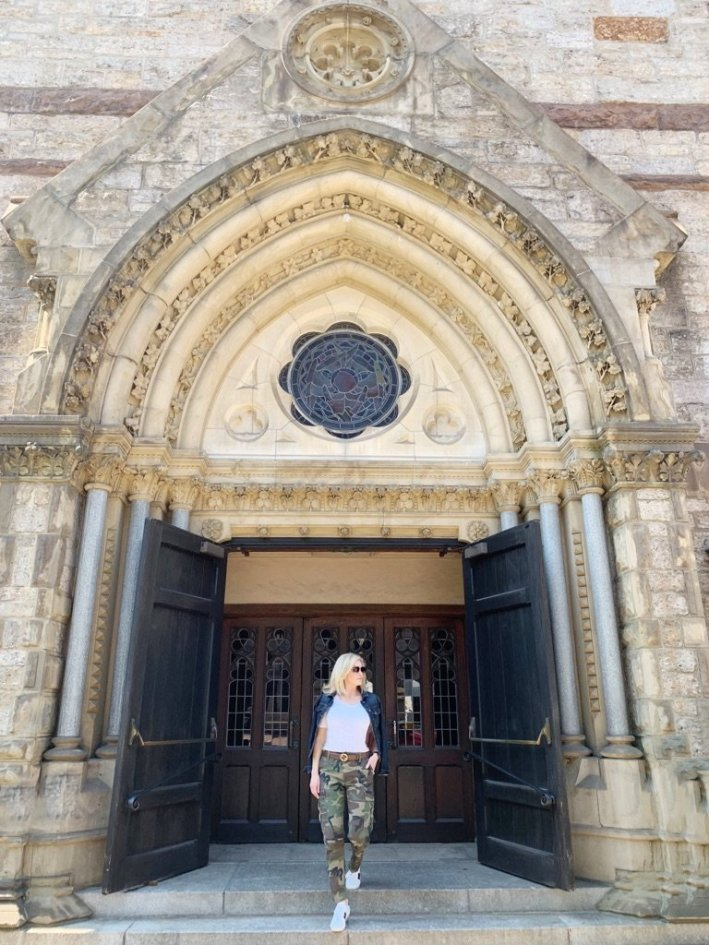 Tanya Foster visits Boston and shares her recommendations | Destination: Boston, Massachusetts Travel Guide by popular Dallas travel blogger, Tanya Foster: image of a woman standing on the steps of a cathedral.