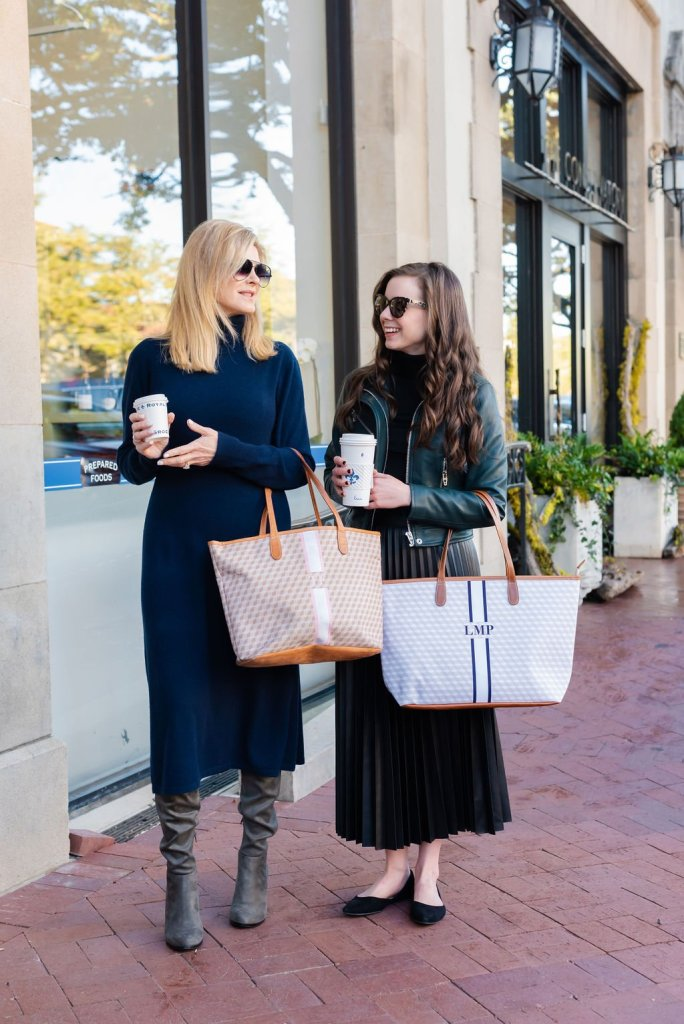 tanya foster and assistant walking with barrington tote bags and coffee celebrating national coffee day