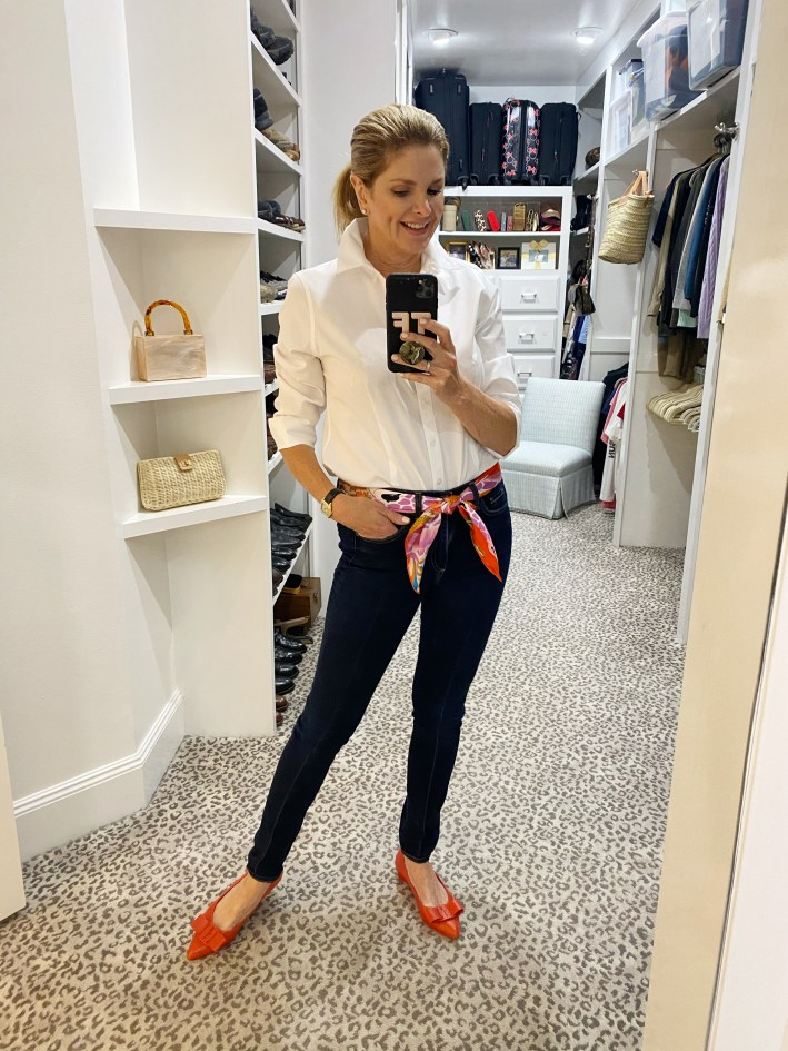 Tanya Foster in veronica beard kate skinny jeans white button down blouse hermes scarf and orange flats