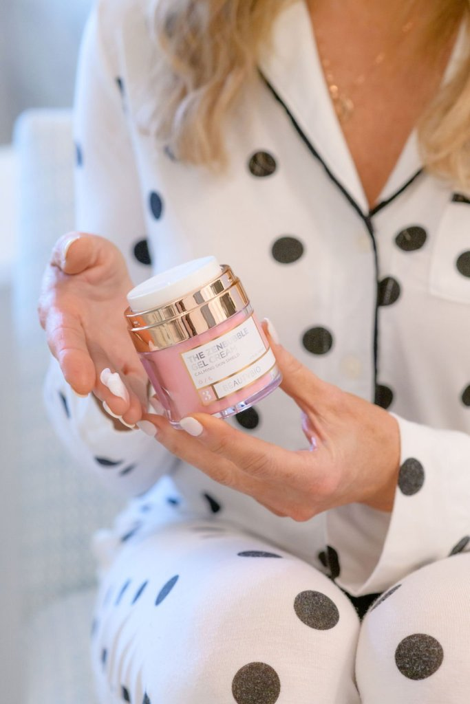 Tanya Foster in soma cool night pajamas holding beautybio zen bubble gel creme
