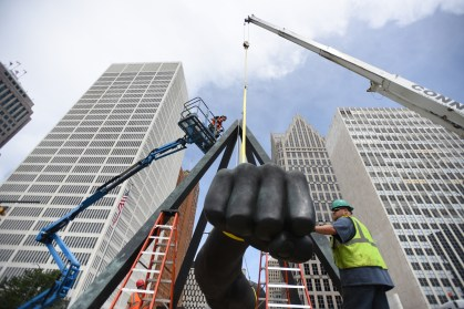 Detroit Institute of Arts staff and Precision Installation and Services worked Wednesday afternoon to replace the steel suspension cables that holds the 5,000 lb. 'Monument to Joe Louis,' or 'The Fist' as it is known, June 24, 2015. The conservation work is done about every 10 years to maintain the 1986-sculpture given to the DIA by Sports Illustrated Magazine, which sits on Woodward Ave. and Jefferson in Downtown Detroit. (Tanya Moutzalias | MLive Detroit)
