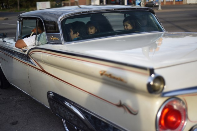 A family squeezes into the backseat as the sun begins to set during the 17th annual Blessing of the Lowriders in Southwest Detroit. The annual event brings car owners and families together to bless their custom cars before the start of cruising season on Sunday May 3, 2015. (Tanya Moutzalias | MLive Detroit)