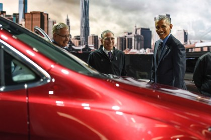 "President Barack Obama takes a look at the new 2017 Chrysler Pacifica alongside (left) Mitch Clauw, Fiat Chrysler's vice president of vehicle of engineering, and Paul Sabatini, NAIAS Chairman while touring the 2016 North American International Auto Show at Cobo Center in Detroit Wednesday, Jan. 20, 2016. ""Beautiful. You guys remember 'Get Shorty,' right? It's cool driving a minnivan,"" said the President. (Tanya Moutzalias 