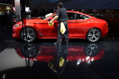 A worker clean the 2017 Infiniti Q60 Sports Coupe. Thousands of visitors attend the 2016 North American International Auto Show for Ôfamily dayÕ on Friday at Cobo Center in Detroit, Jan. 22, 2016. (Tanya Moutzalias | MLive Detroit)