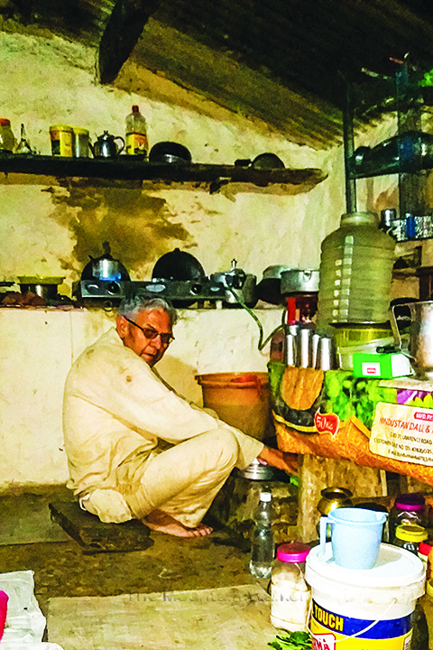Mela Ram Uncle busy with chores in the kitchen; Photo: Ameen Shaikh