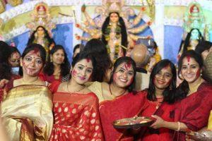 Enjoying Durga Puja. Photo courtesy: Upasana M Pal