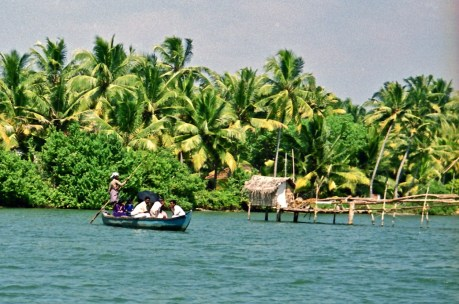 backwaters, Kerala. All but one of the passengers in the boat are hiding their faces from the camera. This was a common reaction.