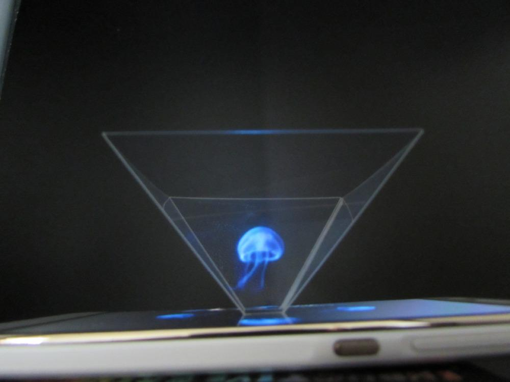 This is an image of a hologram projector you can buy. It is sitting on a tablet.