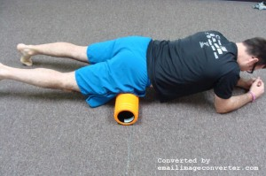 Place foam roller beneath the top of the hip bone. Lie with one hip on the roller. Opposite hip is off the foam roller.