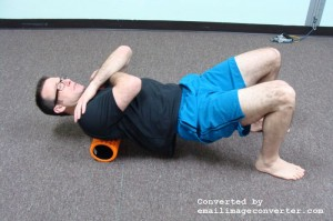 Place foam roller at on upper back. Massage from the top of the shoulders to the bottom of the rib cage. Roll your body 10 degrees to massage the spinal erectors (muscles that run parallel to the spine).